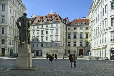 holocaust: Vienna, Austria - March 27th 2016: Unidentified people on Jewish squarewith  Gotthold Ephraim Lessing monument and Holocaust memorial in the inner city