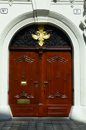 monarchy: Vienna, Austria - March 27th 2016: Entrance with symbol of Habsburg monarchy, constitution court of Austria on Jewish Square in inner district