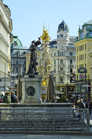 precinct: Vienna, Austria - April 24th 2011: unidentified people on pedestrian precinct Graben with lions fountain aka Saint Florian and plague column in the inner city