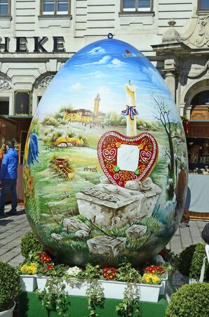 giant easter egg: Vienna, Austria - March 27th 2016: Arful decorated giant easter egg on traditional Easter market on Freyung square