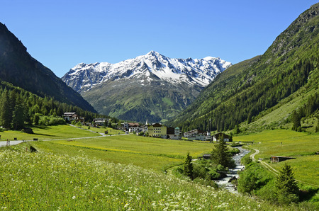 preferred: Plangeross, Austria - June 23rd 2016: Tiny village in Pitztal with snowy Tyrolean alps in background, preferred area for skiing and hiking