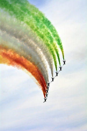 tricolour: Zeltweg, Styria, Austria - September 2nd 2016: Display from Italian Frecce Tricolori aka Tricolour Arrows with Aermacchi aircrafts by public airshow named Airpower 2016