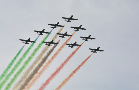 tricolour: Zeltweg, Styria, Austria - September 2nd 2016: Airshow named Airpower 2016 with different aircrafts, formation flight Frecce Trocolori akak Tricolour Arrows with Aermacchi MB-339, an Italian military trainer aircraft Editorial