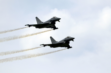 airpower: Zeltweg, Styria, Austria - September 2nd 2016: Pair of Euro Fighter jets from Austrian aircraft by public airshow named Airpower 2016 Editorial