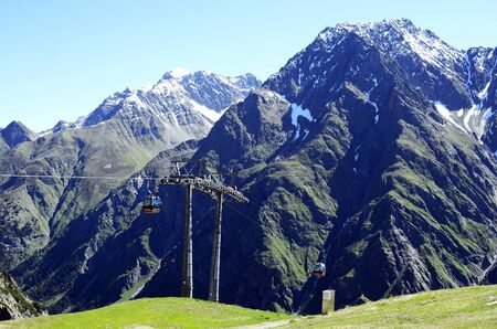 landscape mode: Mandarven, Austria - June 23rd 2016: Cable car named Rifflsee Bahn up to hiking and skiing area in Tyrolean Alps Editorial