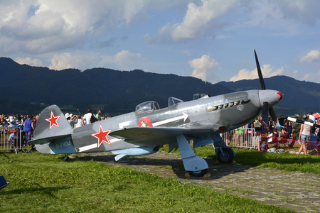 airpower: Zeltweg, Styria, Austria - September 2nd 2016: Vintage Russian Fighter aircraft Yakovlev Yak-3 and crowd of people on airshow named Airpower 2016