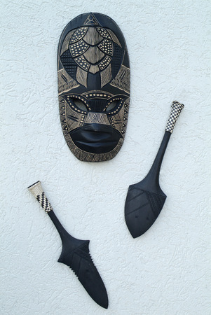 weapons: wooden mask and weapons from Melanesia Stock Photo