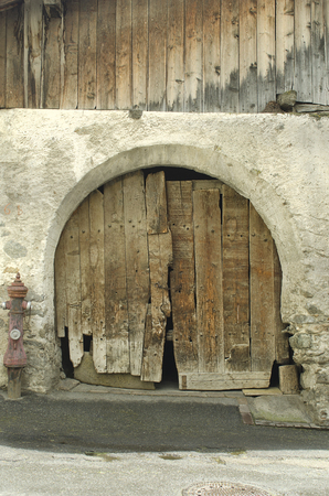 Italy, old building with wooden gate in South Tyrol