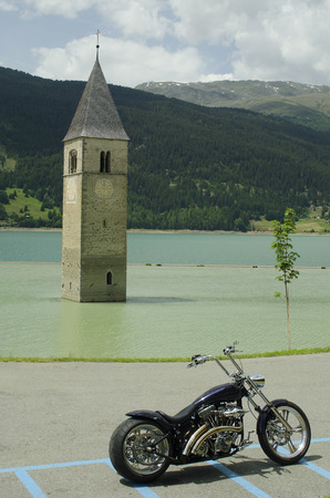 church tower: Italy, sunken church tower in Reschen Lake - Lago di Resia - in South Tyrol and motor bike Editorial