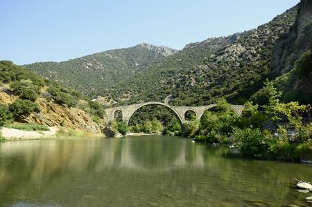 Greece, old Byzantine bridge over river Kompsatos