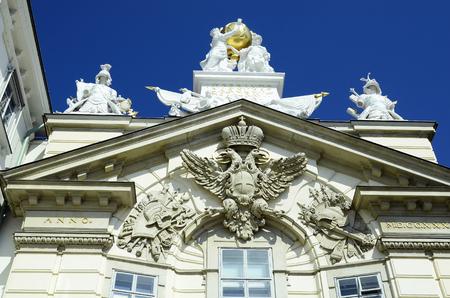 Austria, facade of former civilian arsenal with decoration and emblem Redakční