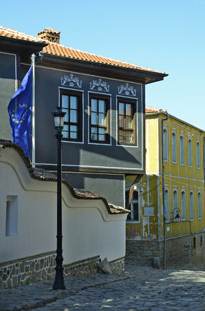 unesco culture heritage: Bulgaria, Plovdiv, Unesco World Heritage site Old Town district, became European Capital of Culture 2019, building in traditional structure with EU flag Editorial