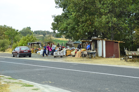 traditon: Gabrovo, Bulgaria - September 22nd 2016: Unidentified people on street market along main road, a traditional kind of shopping for fruit and vegetable in rural area