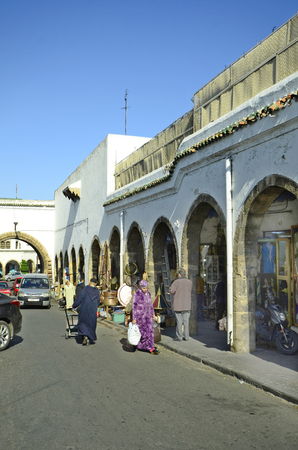 arcades: Casablanca, Morocco - November 18th 2014: Unidentified people in traditional clothing in the arcades of the shopping center named souk with shops with different goods Editorial