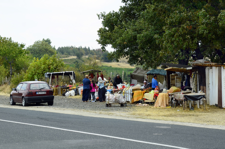 rural area: Gabrovo, Bulgaria - September 22nd 2016: Unidentified people on street market along main road, a traditional kind of shopping for fruit and vegetable in rural area