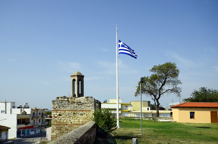 belltower: Greece, old bell tower and Greek flag in Feres
