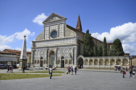 Florence, Italy - June 13th 2012: Gothic church Santa Maria Novella and obelisk on Piazza de La Repubblica