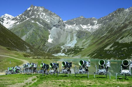 Pitztal, Tyrol, Austria - June 23rd 2016: snow cannons in front of Rifflsee lake in Tyrolean Alps Editorial