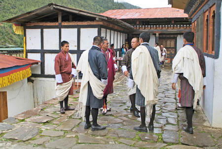 religious clothing: Haa, Bhutan - September 20th 2007: Group of unidentified people in traditional clothing by religious ceremony named Tshechu