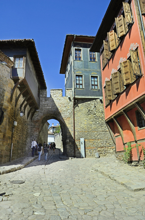 unesco culture heritage: Plovdiv, Bulgaria - September 23rd 2016: Unidentified tourists on sightseeing with medieval arch Hisar Kapia and buildings in traditional structure in Old Town district aka Staria Grad, a Unesco world heritage site, became European Capital of Culture 2019