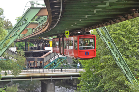 Wuppertal, North Rhine-Westphalia, Germany - May 27th 2011: Unidentified people and public overhead train in station, usual mode of transport in the city