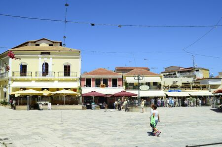 Zakynthos, Greece - May 26, 2016: Unidentified people and buildings with, cafe, restaurant and shops in the capital of the island