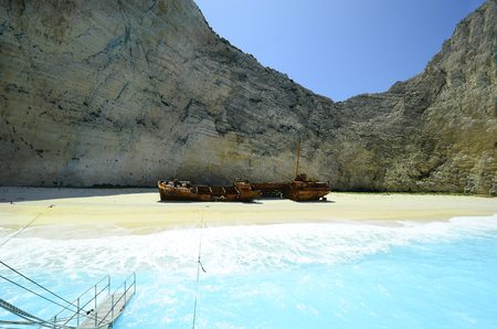 Zakynthos, Greece - May 25th 2016: Wreck of stranded vessel on shipwreck beach, preferred travel destination and landmark on the island in Ionian sea