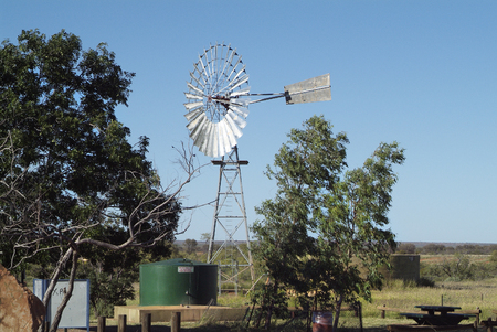 cisterna: Australia, cistern and wind wheel on a parking area in Northern Territory