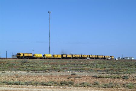 transmitting: Pimba, Australia - April 12, 2010: Railway at station and transmitting mast in outback of South Australia