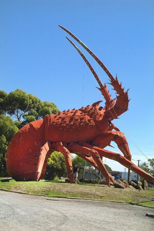 Kingston SE, Australia - January 26, 2008: Unidentified woman on sculpture for The Big Lobster - landmark and sign for a restaurant