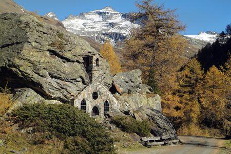 Austria, small chapel built into rocks named Felsenkapelle in Nationalpark Hohe Tauern Stock Photo