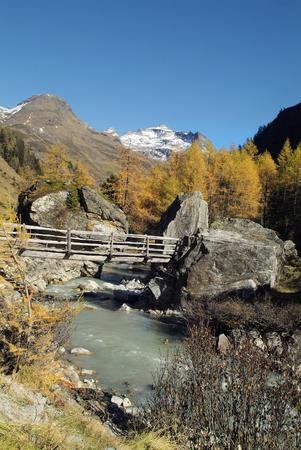 Austria, creek and wooden bridge in nationalpark Hohe Tauern Stock Photo