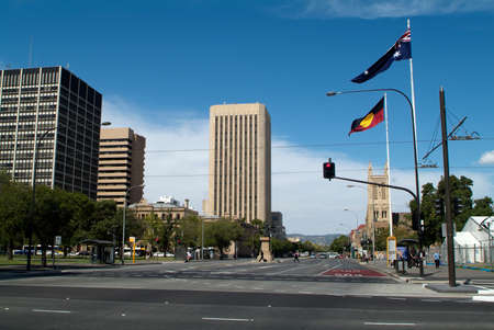 adelaide: Adelaide, Australia - January 30, 2008: Different buildings in Wakefield Street with St. Francis cathedral, Aboriginal and Australian flags