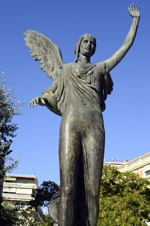 Kavala, Greece - September 23rd 2012: statue of Goddess Nike, the bronze statue of victory is in the Iroon publicgarden and made by sculptor John Parmakelis Editorial