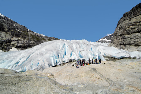 breen: Jostedalen, Norway - June 13, 2009: Group of unidentified tourists on glacier tongue of Nigardsbreen gacier in Sogn og Fjordane