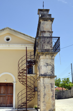 spiral staircase: Greece, Zakynthos, bell tower with spiral staircase in mountain village Loucha Stock Photo