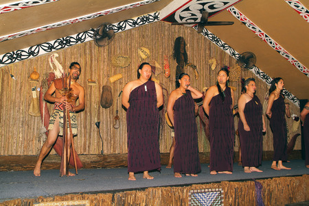 Rotorua, New Zealand - March 12th 2005: Unidentified actors in traditional outfit with tatoos by Maori show
