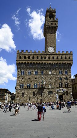 tourisms: Florence, Italy - June 13, 2012: Crowd of unidentified tourists on Piazza della Signoria in front of the old town hall - Palazzo Vecchio