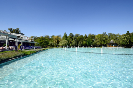 Plovdiv, Bulgaria - September 23, 2016: Unidentified people on lake with singing fountains in Tsar Simeon garden and restaurant, preferred place for relaxing