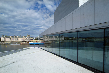 Norway, new opera building and ware house on sea shore in Oslo