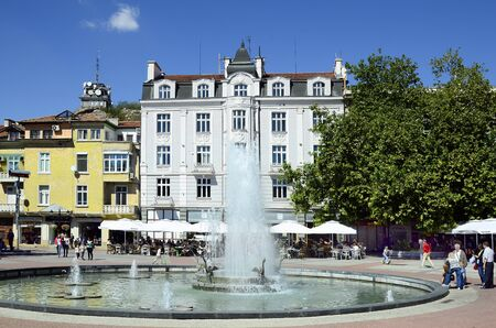 precinct station: Plovdiv, Bulgaria - September 23, 2016: Unidentified poeple and buildings around fountain on Stefan Stambolov square in pedestrian precinct in inner city