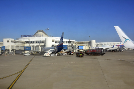 Antalya, Turkey - October 14th 2015: Terminal with aircrafts, luggage and fire truck on Antalya airport Editorial