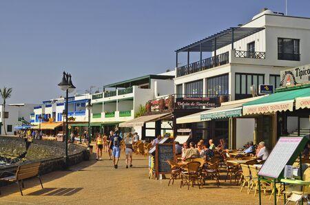 blanca: Playa Blanca, Lanzarote, Spain - January 15, 2012: Unidentified people on promenade in Playa Blanca, preferred destination with restaurants and shops along the sea shore Editorial