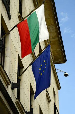bulgarian: Sofia, Bulgaria, Bulgarian flag and EU flag on unknown building