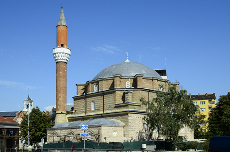 Sofia, Bulgaria - September 25th 2016: Unidentified people and Banya Bashi mosque with minaret 報道画像