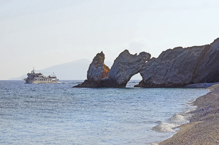 reachable: Skiathos, Greece - October 3rd 2012: Excursion boat from Skiathos town to Lalaria beach with natural rock hole, the beach is reachable only by boat and a preferred destination for tourists to relax and swim