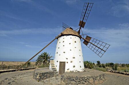 archtecture: Spain, Canary Island, Fuerteventura, windmill in traditional structure in El Roque village Stock Photo