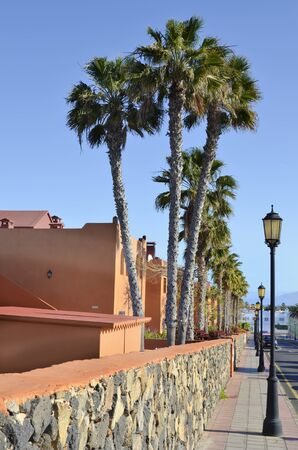 Spain, Canary Island, Fuerteventura, facade of buildings and lanterns on street Stock Photo