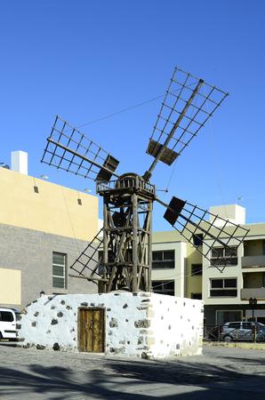 Spain, Canary Island, Fuerteventura, old windmill named Molina de Juan Morera inmidst Corralejo village Stock Photo