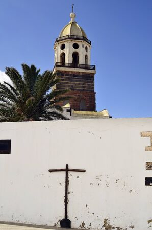guadalupe island: Teguise, Lanzarote, Canary Island, wall with cross and church Iglesia de Nuestra Senora de Guadalupe